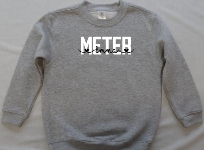 sweater met opschrift: meter